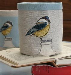Fabric Pots - I embroidered a blue tit on a cushion, this looked similar, must do more embroidery!