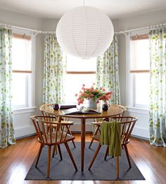 look at that light! love it. love the windows, curtains, table and chairs!