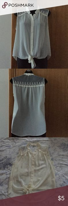 Cream sleeve less top See through High-Low top with tie in the front. Has a flower like pattern in the front around the shoulders as well as the back. NOT Forever 21 just under to get views 😊 Forever 21 Tops Tees - Short Sleeve