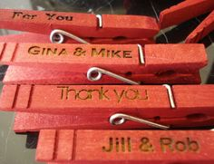 100 Custom Clothespin Wedding Favors Red place card holders. $50.00, via Etsy.