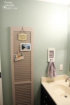 Painted shutter as bathroom decor (behind the door)