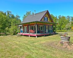 I dig the porch. I hate the paint job, and I'd add dormers to the roof line or change it completely. ... But I dig the porch :)