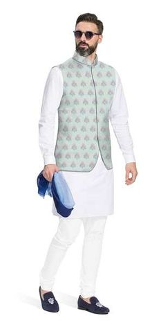 Estevao This beautiful classic cotton kurta is complimented with a dash of color in the Rajasthani inspired floral butas embroidered Nehru Vest. Wedding Kurta For Men, Wedding Dresses Men Indian, Wedding Dress Men, Wedding Suits, Wedding Groom, Wedding Ceremony, Reception, Mens Indian Wear, Indian Groom Wear