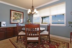 A dining room with wood accents with a beautiful ocean view in Maui, Hawaii. 33 Kokea