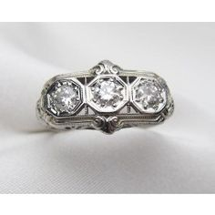 Circa 1930. This is a beautiful Art Deco three stone diamond ring with detailed filigree work.  The total diamond weight is .45 carats, with a clarity of SI1 and color H-I.  Appraisal Value: $2940.