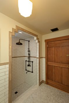 Love the cupboard idea. Bronze fixtures and white subway tile with lighter brassy tile around it.