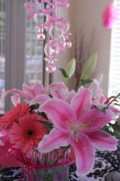 Baby shower flowers and pacifier chandelier decor, baby shower ideas