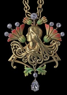 PLISSON & HARTZ Art Nouveau Pendant/ Brooch. An iconic Mucha style Art Nouveau portrait in gold of a young girl with cascades of sinuous hair curls, set against a formalised arrangement of chrysanthemum flowers symbolising good fortune. France, circa 1900