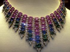 Bulgari ~~ gorgeous yellow-gold necklace with pink & blue sapphires (132.19c), emeralds (24.10 c) and rounded brilliant-cut-diamonds.