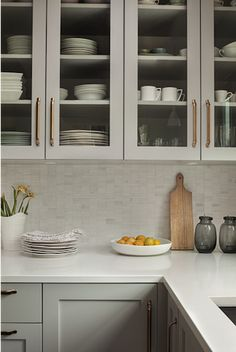 gray cabinets, brass pulls, marble backsplash