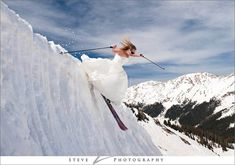 Hitting the slopes in a wedding dress...oh, she's a keeper! Photo: Steve Z. Photo idea for #MammothWeddings