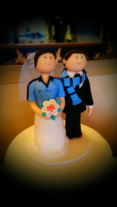 Cake topper for two Dublin GAA fans! Dublin, Cake Toppers, Wedding Cakes, Fans, Board, Desserts, Tailgate Desserts, Deserts, Wedding Pie Table