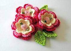 Crochet Roses ... brooch ... silk coiled ribbon rose in center of each layered crochet flower ... sweet!!