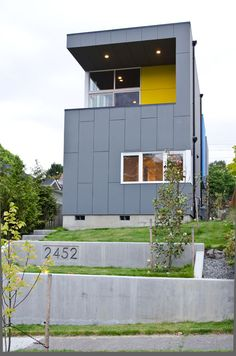 Lovely modern design gracing the the streets of Seattle neighborhood.  I'd think the gray exterior would draw in the often overcast skies of the area, and then the bright colors would really punch up the visual impact of the house.