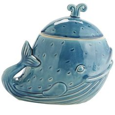With a whale of a story, our cookie jar is happy to tell its tale. Ceramic and displaying a big smile, Wallace is ready to watch over your precious baked goods. Now that's something to spout off about.