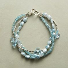 """ICE STORM BRACELET - Sterling silver beads glisten among the cool hues of blue zircon, topaz and mystic sapphire in this bracelet. Three strands; lobster clasp. Handmade in USA exclusively for us. 7-1/2""""L. $298"""