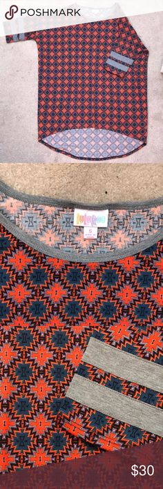 LuLaRoe Irma LuLaRoe Irma- Small. Only worn and washed 1 time. Loose fitting. Tunic Length- Longer in the back so perfect with leggings! Orange, Blue, Black, Gray, and a tiny bit of a Purple-ish color. See last photo for details on fit and true size. Make me an offer with the offer button!! LuLaRoe Tops Tunics