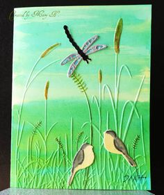 Watercolor background made using Distress Inks, embossed with Darice Grass, Derwent Inktense pencil coloring, IO birds shaded with copics, Elizabeth Craft dragonfly