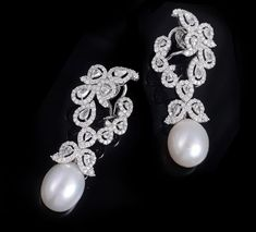 Farah Khan.Diamond earrings with South Sea Pearl set in 18K white gold.