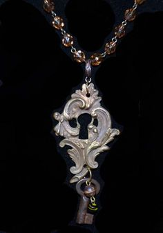 Antique Paris Brass Keyhole Pendant With Amber by Incarnations,inc.on Etsy $30.00