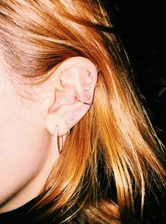 """These Are The New """"It Piercings"""" #refinery29  http://www.refinery29.uk/cool-ear-piercing-ideas#slide-3  Fret not if you're nervous about going into cartilage territory. Multiple piercings in the lobe are still having a huge moment (and heal much faster), but it's all about being creative with the spacing. """"For girls that have come in with multiple lobe piercings, I've started to go above them, vertically,"""" he says. """"I find it..."""