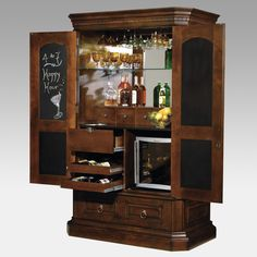 Hide-A-Bar liquor cabinet is meant to look like an armoire when the doors and…