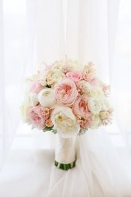 Bouquet peonies, ranunculus, garden roses, polo roses, freesia, mini roses, lisianthus, hydrangeas, astilbe, and dusty miller