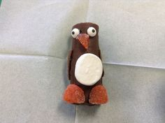 Penguin from a Swiss cake roll, cut large marshmallow, orange spice drops and flattened tootsie roll wings.  Big hit with 4 year olds!