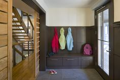 like simple trim detail, hooks/bench/drawers [or open cube] could work around double window. valspar 'bark' color