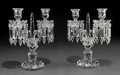 A Pair of Baccarat Molded Glass Two-Light Candelabra, 20th c., marked, hexagonal standard issuing scrolled candlearms, with swirl molded base
