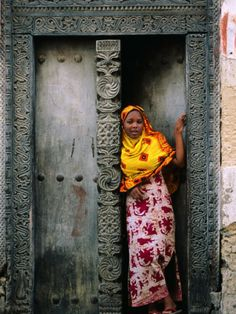 size: Photographic Print: Swahili Girl in Zanzibar Doorway, Bagamoyo, Tanzania by Ariadne Van Zandbergen : Travel Out Of Africa, East Africa, African Great Lakes, Stone Town, Framed Artwork, Wall Art, African Countries, People Of The World, African Art
