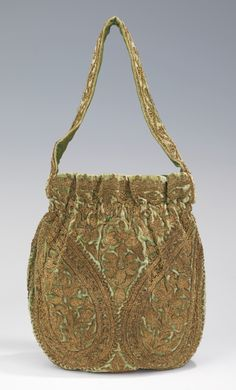 "Evening Bag, Jeanne Lanvin (French, 1867–1946) for the House of Lanvin (French, founded 1889): ca. 1925-1935, French, silk, metal silk, metallic. ""The flower-filled boteh, otherwise known as the paisley, on this couture handbag imitates the decorative element which first appeared on Indian shawls and ornamentation in the 16th century. Lanvin was known for her detailed embroidery and often incorporated non-Western motifs inspired by her travels."""