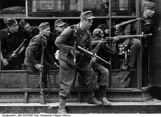 """Soldiers tentatively identified as members of the SS-Sturmbrigade """"Dirlewanger"""" in Downtown Warsaw in 1944"""