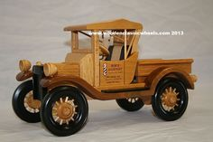 """1919  Model T Ford Runabout   # 21 FR  a classic pickup truck that every model truck collector must have.  Built from: solid hard maple, black walnut finders w / painted black spoke wheels  Approx. size 14"""" Long X 10"""" Tall X 8"""" Wide"""