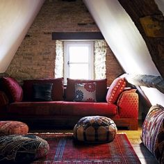 Nifty idea for an attic, although it would work well in a library.  Looks like the hassocks are sneaking up on the sofa.