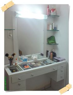 Make-up station. Like the corner shelves. Perfect idea for my future makeup station
