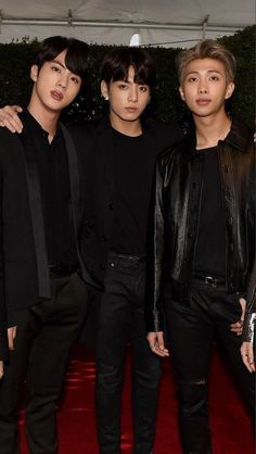 They look like two rich parents and Jungkook the heartbreaker son.