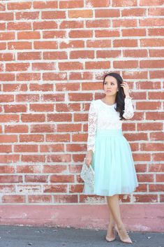 Lace top, pleated tulle skirt with sequin clutch and pumps // Click on the following link to see more photos and outfit details:  http://www.stylishpetite.com/2014/08/lace-and-tulle.html