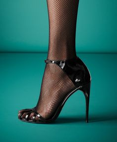 Gucci Margot Patent Leather Cage Sandal   Who would've thought that stocking and open-toed shoes could be hot?