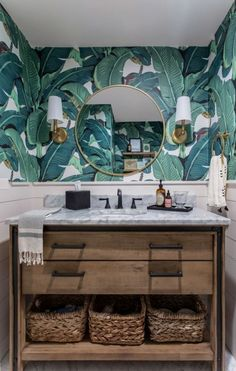 I had so much fun designing this modern farmhouse home in San Jose! This couple wanted a farmhouse look with Spanish and Hawaiian elements, and it turned out beautifully. I designed the bathroom with a Hawaiian theme with tropical leaf wallpaper and a wooden vanity with straw woven baskets. See more of this modern tropical bathroom transformation on my site! Versailles, Tropical Bathroom Decor, Wooden Bathroom Vanity, Interior Design Work, Interior Ideas, Modern Powder Rooms, Tropical Wallpaper, Modern Tropical, Bathroom Wallpaper