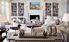 Love the built in book cases around the fireplace. @Deborah Griffith  you could easily set your living room up like this.. You have all the pieces!!