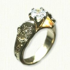 Custom Astrological Aquarius Engagement Ring Photo-etched reverse etch pattern with  Aquarius and other astrological symbols. Ring is shown in 14kt yellow gold with a 1.01ct round brilliant cut diamond