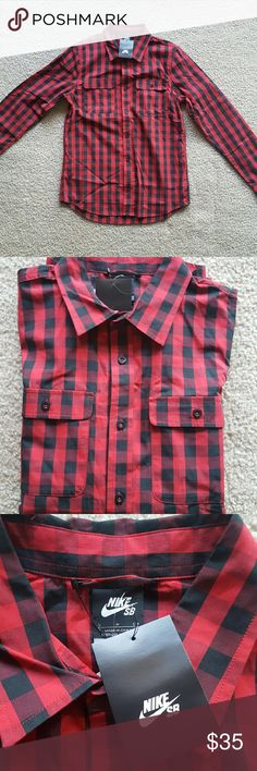 Nike SB Plaid Shirt - Small Brand new with tags men's Nike SB long sleeved button down shirt. Red and black plaid, featuring button closures.    Originally $70, brought for $45 and can be yours for $35.  *** Consider bundling to save on shipping***  #nike #nikesb #skateboarding #plaidshirt #mensshirt Nike Shirts Casual Button Down Shirts