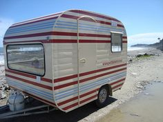 Restored vintage caravan, love the stripes. Each color scheme I find is more difficult. Chad is going to hate me soon. :)