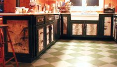 birch bark/green cabinets. I like the birch bark idea