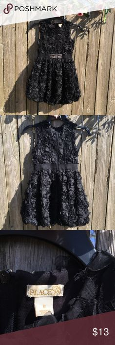 GIRLS Children's Place black ruffle like dress Length of dress-27 1/4 Gently used in good condition  Black all around dress no discoloration lighting was applied that made it seem like discoloration but it's not  Last picture shows a section of the dress a pieces of fabric is loose but goes with the style of the dress not noticeable Dresses