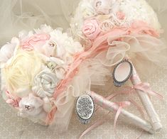 These bridesmaid bouquets are simply perfect for Princess Aurora's girls. Re-create them with multiple hues of tulle and ribbon. The flowers are an elegant mix of shades of blush, ivory and antique white. Silk flowers can easily be mixed with cloth or lace roses for a keepsake that will last, or you can ask your florist to design you fresh bridesmaid bouquets using these multi-dimensional colors.