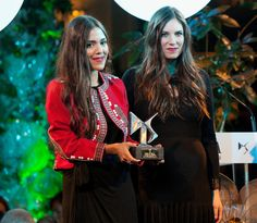 Pregnant Tatiana Santo Domingo with her business partner Dana Alikhani receiving a trophy at the Telva magazine awards