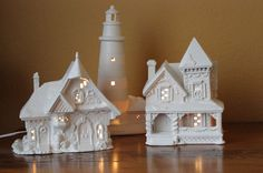 White Christmas houses - my diy.  You know those old Christmas homes you used to love.  Or the ones you saw at Goodwill.  Let me show you how to transform them with spray paint.  An easy DIY.  Create your own white Christmas decor.  - Momcrieff