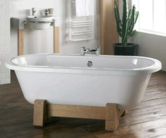 """I like the sturdy wooden """"legs"""" of the bathtub and the floor."""